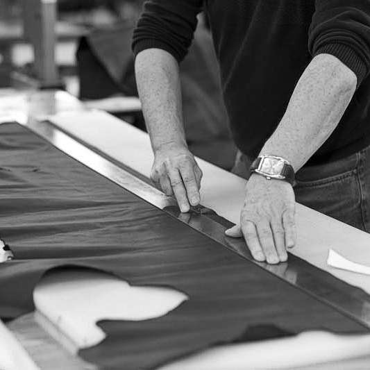 Canvas being cut. The Original Peter manufacturing process in action, showing one of our Original Peter Record Hunting Bags being hand made by Brady Bags in Walsall, England to the highest specification with the highest quality materials.