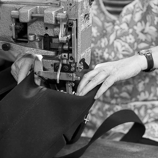 An Original Peter Record Hunting Bag being sewn by hand on a sewing machine. The Original Peter manufacturing process in action, showing one of our Original Peter Record Hunting Bags being hand made by Brady Bags in Walsall, England to the highest specification with the highest quality materials.